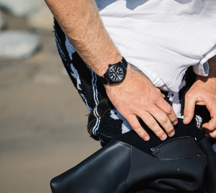 Man outdoors wearing One Eleven watch.
