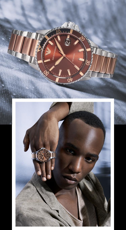 Stylish man wearing navy Emporio Armani watch.