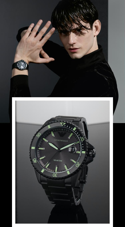 Stylish man wearing navy Emporio Armani watch. Stylish woman wearing striped Emporio Armani watch.