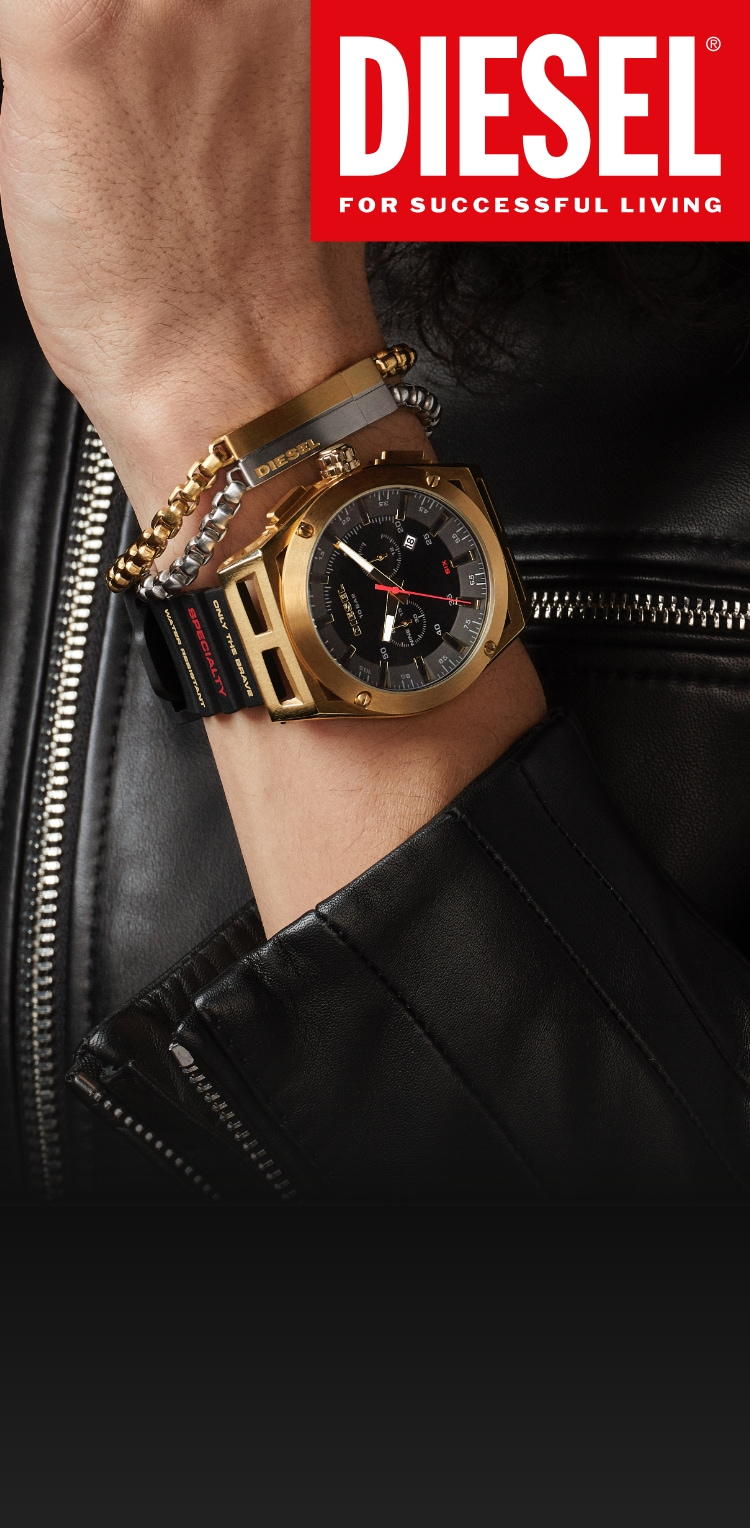 Stylish person wearing silver and gold-tone chain link bracelet with black Timeframe watch by Diesel.