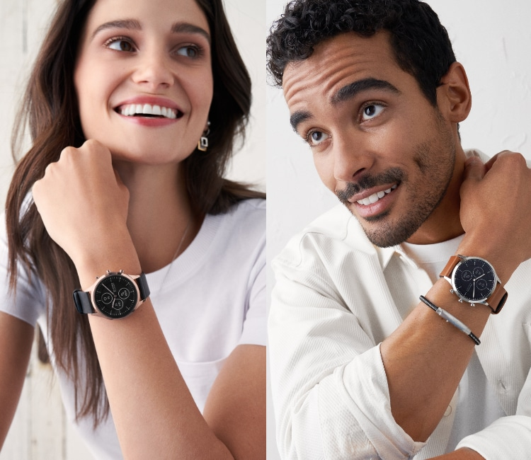 Woman wearing Skagen's Hybrid HR smartwatch featuring black leather strap.