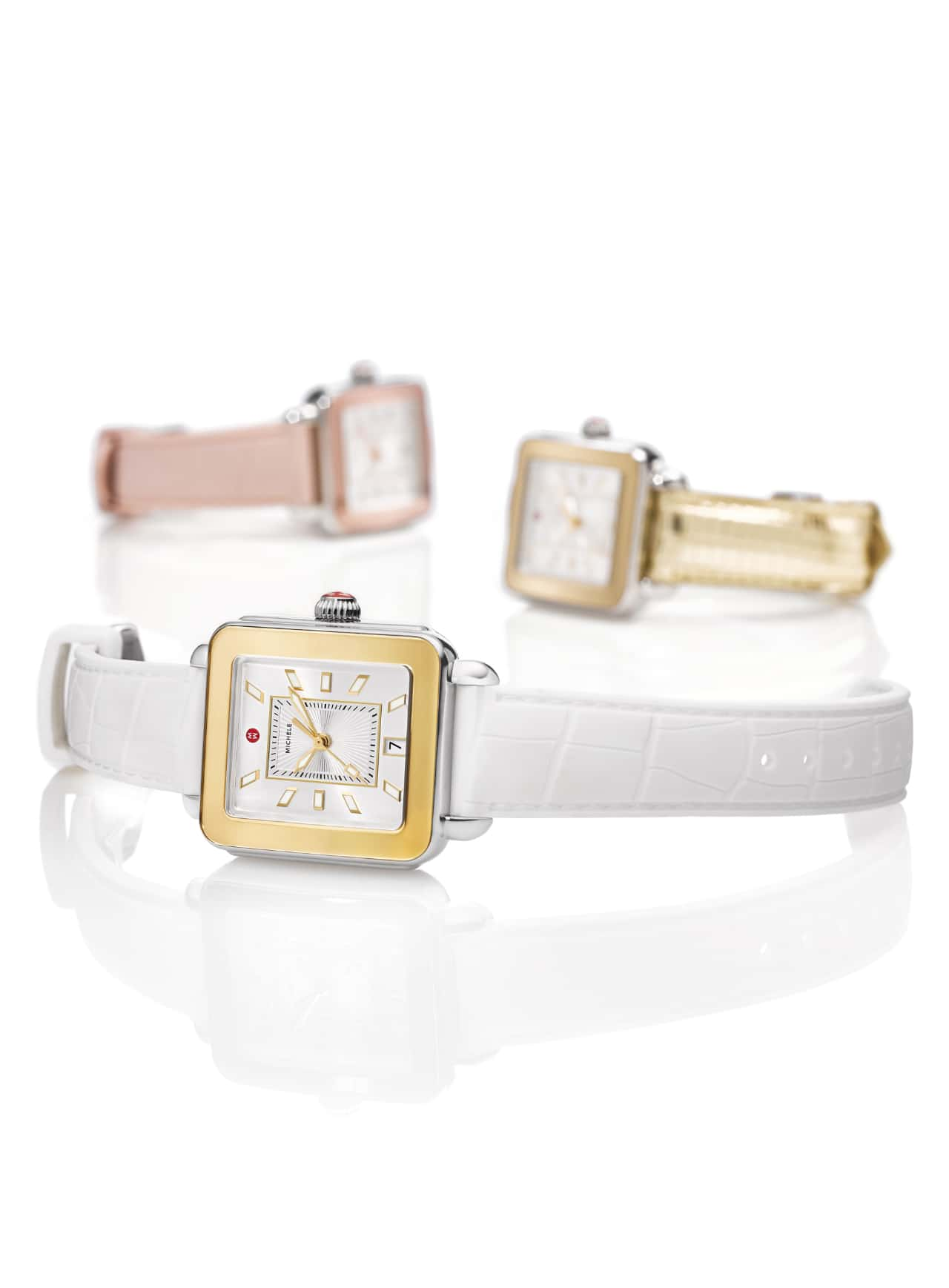 Three Deco Sport watches in white, pink and gold-tone straps.