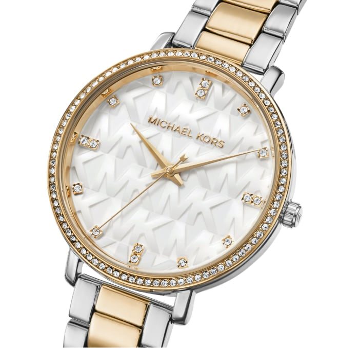 Two-tone Michael Kors watch featuring repeat logo initials atop the dial.