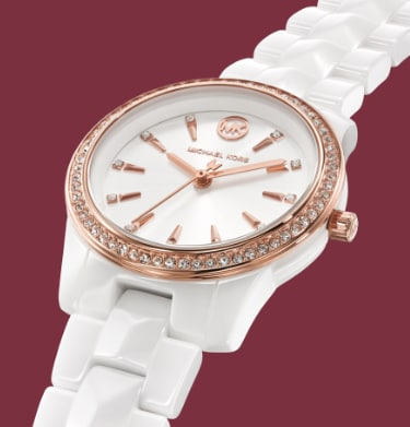 Michael Kors light pink limited-edition Runway watch featuring an aluminum three-link bracelet and glitz-filled dial.