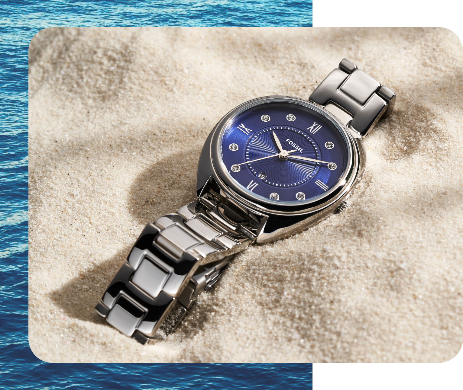 Ladies' Fossil watch featuring blue dial, glitz indexes and stainless steel bracelet.