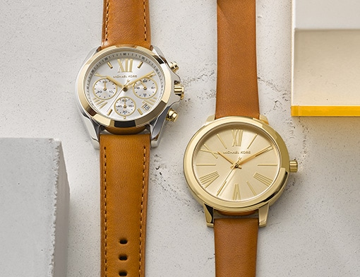 Two watches with brown leather bands