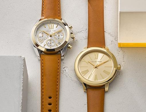 Deux montres avec bracelets en cuir brun