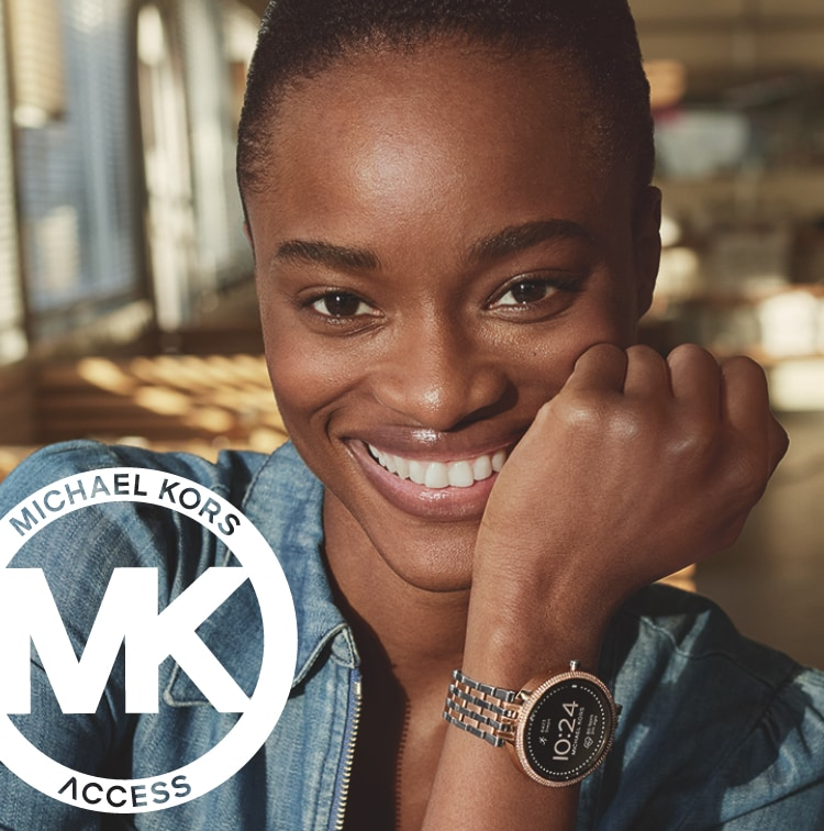 Stylish woman wearing two-tone stainless and rose gold-tone Michael Kors Access Smartwatch.