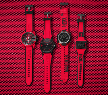 Four Diesel men's smartwatches all with red silicone straps featuring tonal and black logos and buckle closures. Two featuring digital dials.
