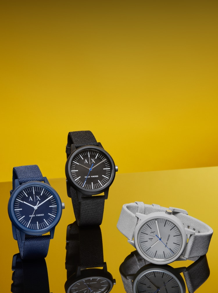 Three sustainable A|X watches in navy, black and grey.