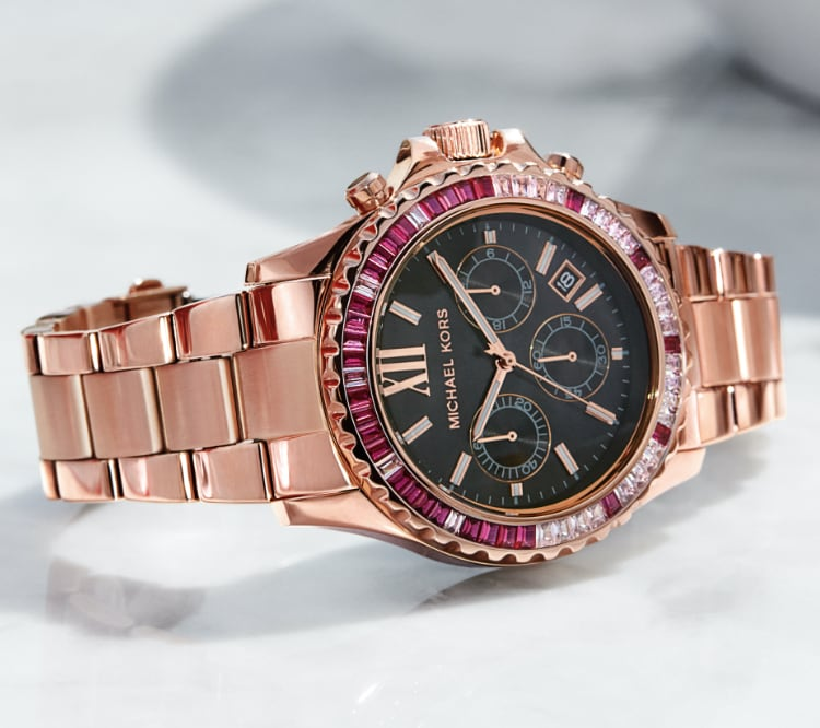 Michael Kors Bradshaw watch in rose gold-tone with a pink glitz topring.