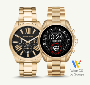 Two men's gold Michael Kors watches.