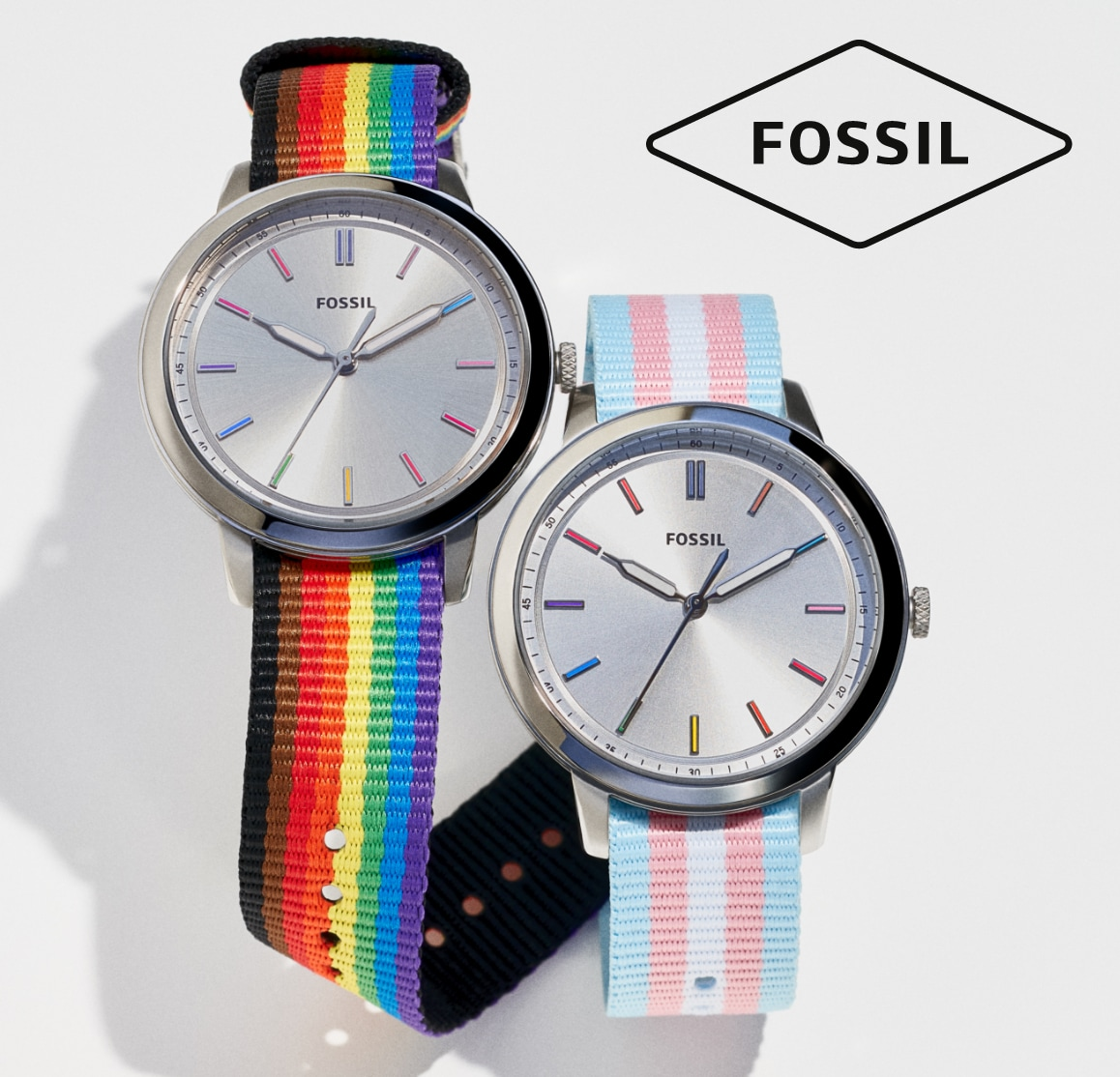 Two Fossil watches with rainbow and pink and blue straps.
