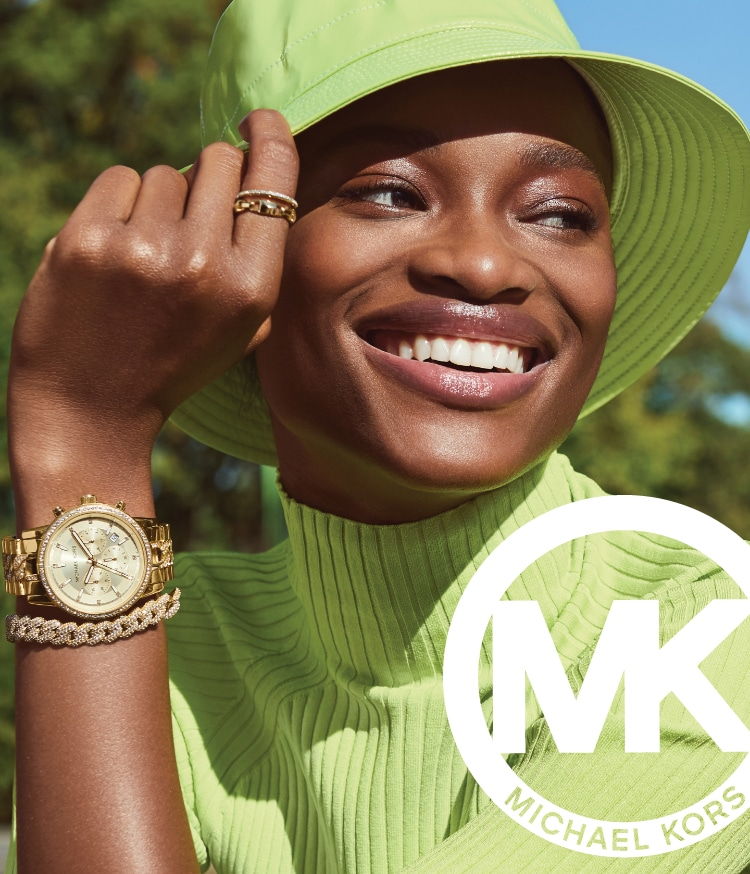 Stylish woman wearing gold-tone stainless steel Michael Kors watch.