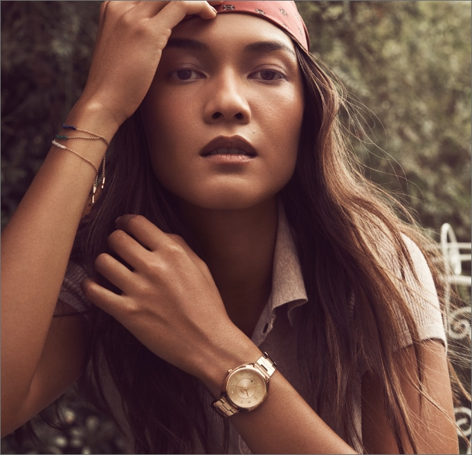 Stylish young woman wearing Fossil's Gabby 70s-inspired Gabby watch.