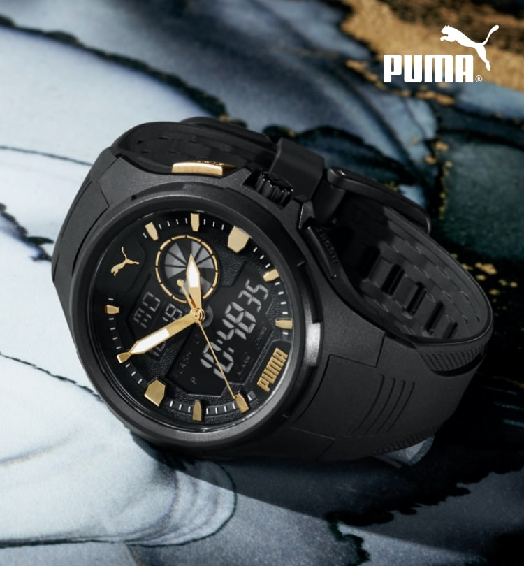 All-black PUMA watch featuring a digital dial and gold detailing.