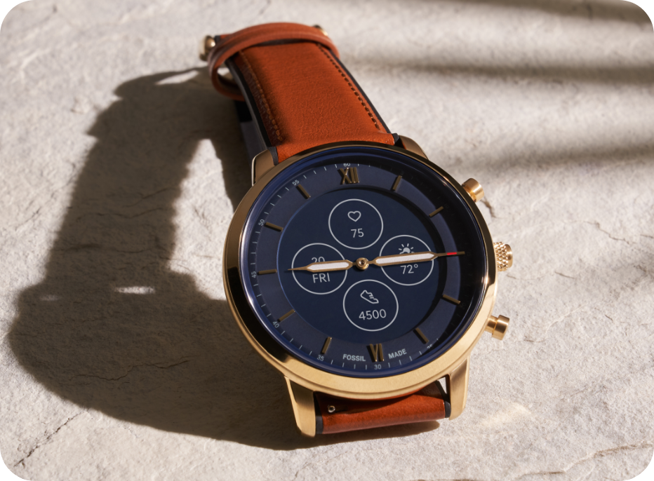 Fossil Hybrid HR smartwatch featuring navy blue dial with brown leather strap.