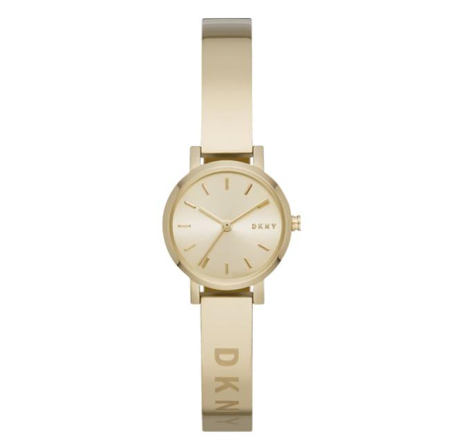 gold tone DKNY watch with a metal bracelet