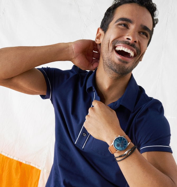 Minimalist style man wearing brown and blue Skagen watch.