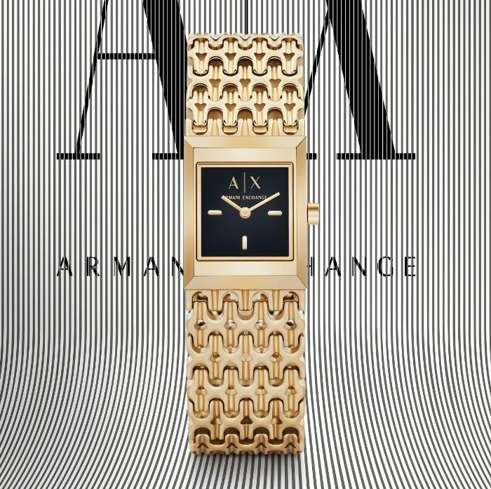 Modern, stylish woman wearing black and white A|X watch.