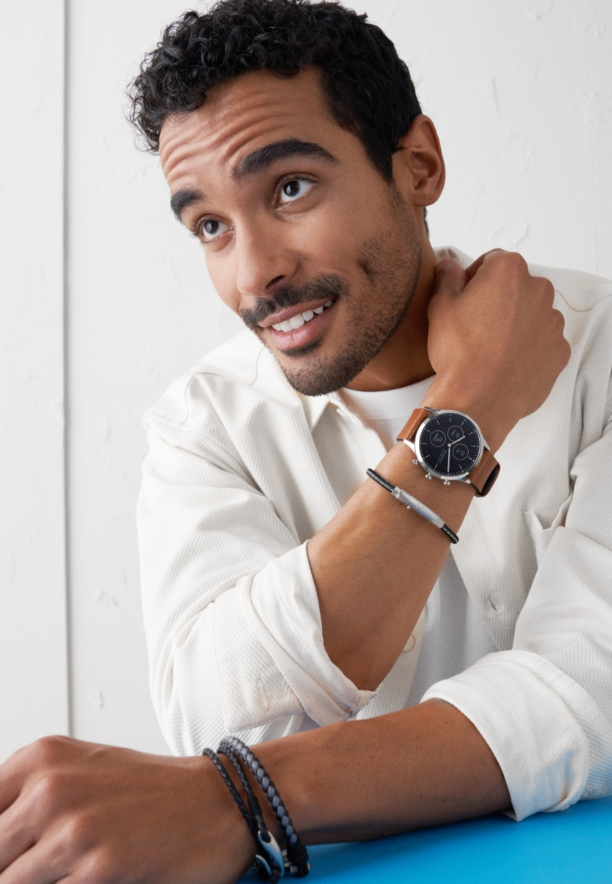 Man wearing Skagen's Hybrid HR smartwatch featuring brown leather strap.