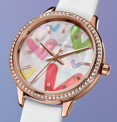 Woman's Michael Kors watch with a multicolor heart-print dial, rose gold-tone topring with glitz and white leather strap.